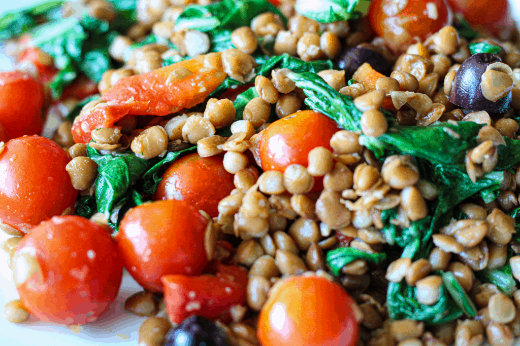 Ginger lentil salad with kale, cherry tomatoes and olives.