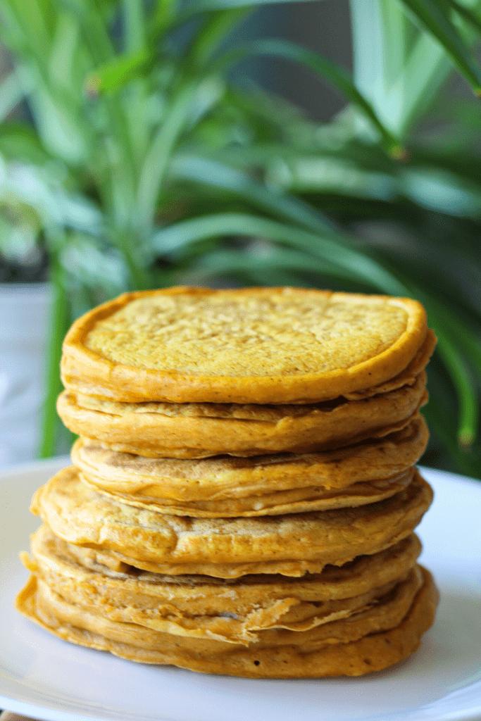 healthy pumpkin pancakes stacked vegan